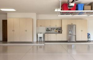 Beige Epoxy Floor Coating in a Garage with Cabinets | Floorguard.com